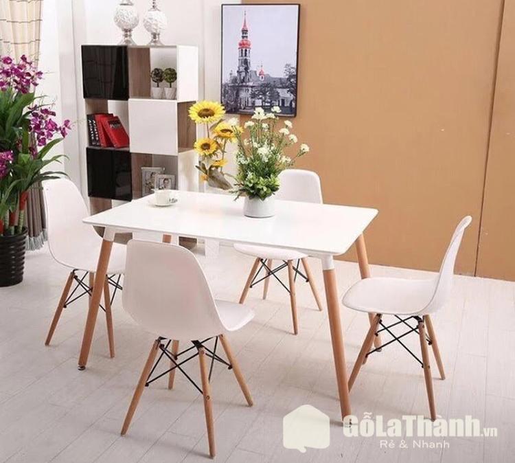 bàn ăn màu trắng ghế nhựa chân gỗ nâu