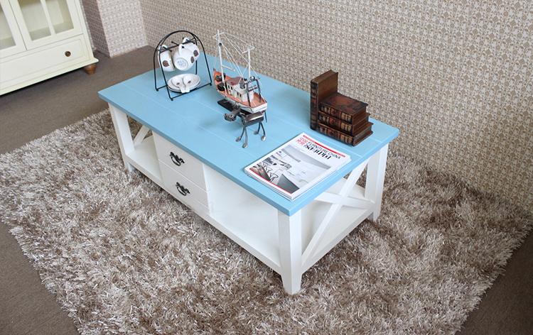 Thiết kế theo phong cách Bắc Âu với 2 tầng và 4 ngăn kéo trượt cùng với điểm nhẫn 2 bên hông bằng họa tiết nan Gỗ vô cùng độc đáo, màu sắc trẻ trung, mẫu bàn trà gỗ này chắc chắn sẽ là làn gió mới cho không gian gia đình bạn