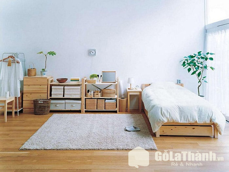 phòng ngủ phong cách tối giản với giường ngủ và nội thất gỗ