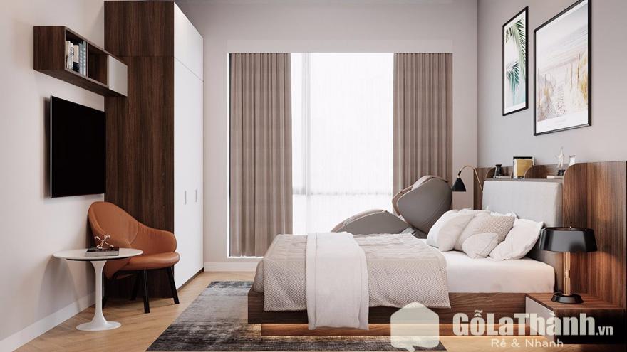 phòng ngủ với giường và tủ đựng quần áo đặt cạnh cửa sổ